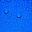 Stock Photo: Water drops on blue background
