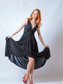 Redhead full body in black dress,studio shot — Stock Photo
