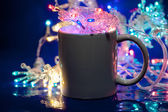 Cup of coffee and christmas garland — Stock Photo