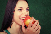 Women playing with apple — Stock Photo