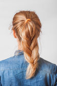 Back view of the blond haired girl with braid — Stock Photo