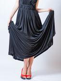 Redhead waist down body in black dress,studio shot — Stock Photo