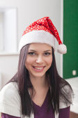 Brunette santa hat indoor — Stock Photo