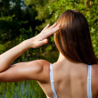 Back side view of young brunette outdoors — Stock Photo #37801299