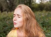 Blonde female headshot outdoors — Stock Photo