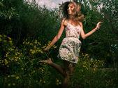 Happy girl dancing — Stock Photo