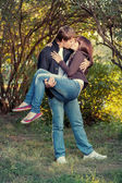 Romantic young couple kissing... — Stock Photo