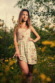Sexy girl in dress posing outdoors — Stock Photo