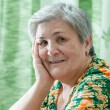 Close up portrait of a happy smiling senior woman — Stock Photo #40584323