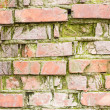 Stock Photo: Obsolete brick wall with significant signs of wear