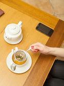 Woman preparing herbal tea. — Stock Photo