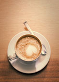Coffee cup with milk on the table — Stock Photo