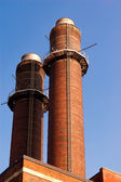 Chimney-stack against blue sky — Stock Photo