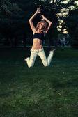 Sporty girl fly — Stock Photo