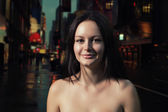 Shirtless brunette smiling in the night street — Stock Photo