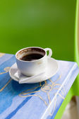 Cofee cup on a table — Stock Photo