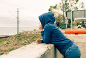 Woman in hooded shirt outdoors — Stock Photo