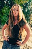 Funny blonde grimacing outdoors — Stockfoto