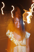 Young girl with lightpainting, long time exposure — Foto de Stock