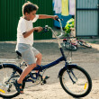 Постер, плакат: Little boy ride on bike