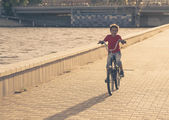 Young boy riding bicycle on a summer day — Stock Photo