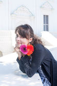 Brunette with flowers in her hands — Stock Photo
