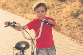 Urban biking - small boy and bike in city park — Stock Photo