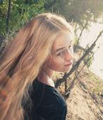 Closeup portrait of blonde women — Stock Photo