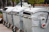 Trash cans in a row outdoors — Stock Photo