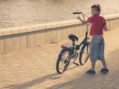 Boy with his bicycle — Stock Photo