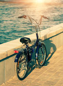 Blue kids bike near parapet — Stock Photo