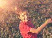Closeup of a boy running backlit — Stock Photo