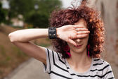 Women hiding her eyes by open palm — Stock Photo