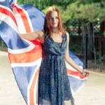 Cute  girl against  holds britain flag — Stock Photo #49257417