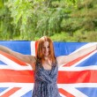 Young beautiful girl  holds britain flag — Stock Photo #49257425