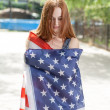 Red haired woman with US flag — Stock Photo