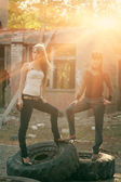 Two women standing on a tyres outdoors — Stock Photo
