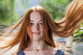 Red hair flying by wind — Stock Photo