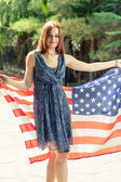 Redhead women posing with US flag — Stock Photo