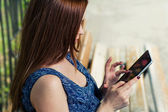 Redhead woman with tablet outdoors — Stock Photo