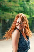 Dancing red haired woman — Foto Stock
