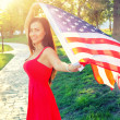 Woman holding american flag. — Stock Photo #51729849