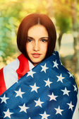 Woman warp in US  flag — Stock Photo