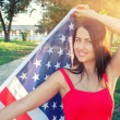 Woman holding american flag — Stock Photo #51730459
