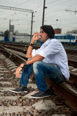 Man is sitting on the rails — Stock Photo