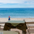 Table on the shore of the sea - Stock Photo