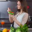 Beautiful woman eats salad - Stock Photo