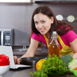 Stock Photo: Womprepares vegetables