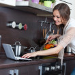 Woman prepares the food in the kitchen — Stock Photo