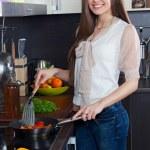 Woman prepares vegetables — Stock Photo #24957653